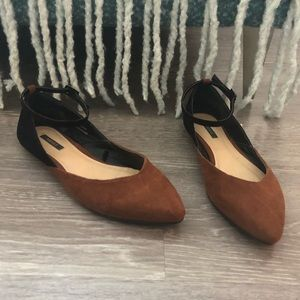 Black and brown flats